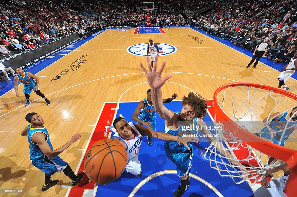 Evan Turner #12 of the Philadelphia 76ers drives to the basket against the New Orleans Hornets at the Wells Fargo Center on January 15, 2013 in Philadelphia, Pennsylvania.