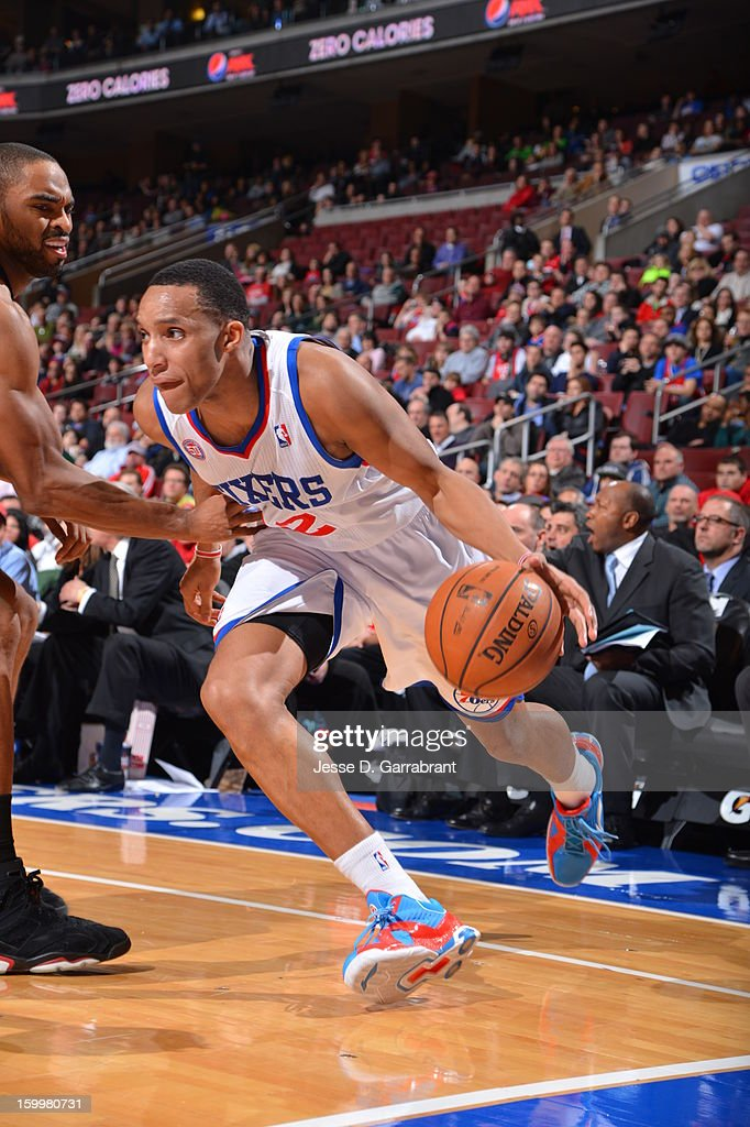 Evan Turner #12 of the Philadelphia 76ers drives to the basket against the Toronto Raptors at the Wells Fargo Center on January 18, 2013 in Philadelphia, Pennsylvania.