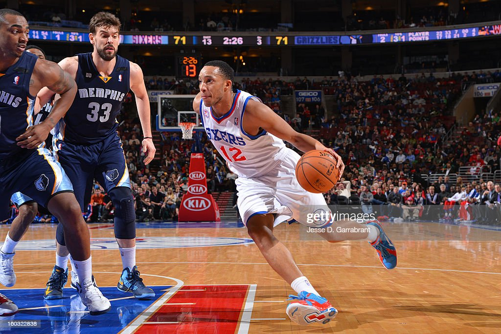 <a gi-track='captionPersonalityLinkClicked' href=/galleries/search?phrase=Evan+Turner&family=editorial&specificpeople=4665764 ng-click='$event.stopPropagation()'>Evan Turner</a> #12 of the Philadelphia 76ers drives to the basket against the Memphis Grizzlies at the Wells Fargo Center on January 28, 2013 in Philadelphia, Pennsylvania.