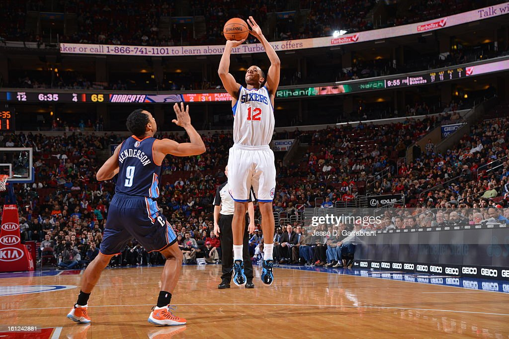 Evan Turner #12 of the Philadelphia 76ers drives to the basket against Gerald Henderson #9 of the Charlotte Bobcats during the game at the Wells Fargo Center on February 9, 2013 in Philadelphia, Pennsylvania.