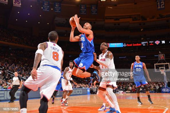 Evan Turner of the Philadelphia 76ers drives to the basket against Amar'e Stoudemire and JR Smith of the New York Knicks on February 24 2013 at...