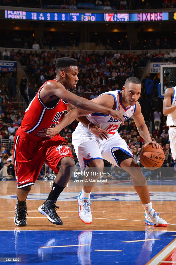 Evan Turner #12 of the Philadelphia 76ers drives to the basket against the Miami Heat at the Wells Fargo Center on February 23, 2013 in Philadelphia, Pennsylvania.