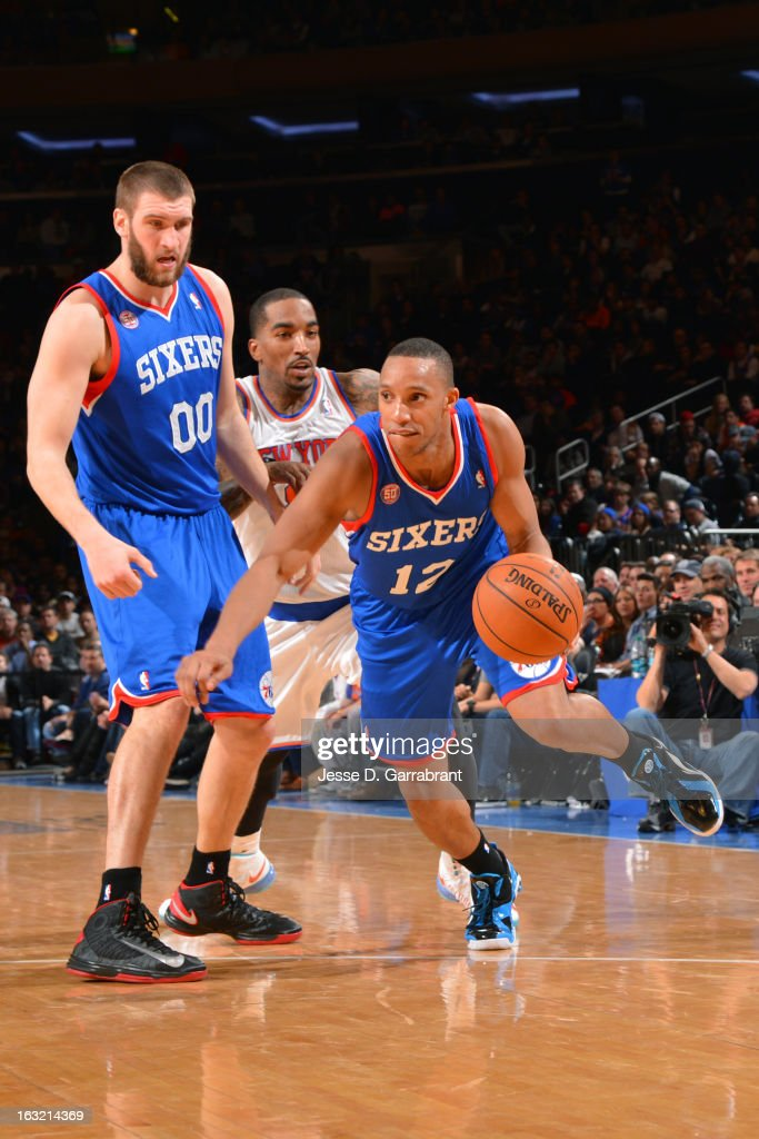 Evan Turner #12 of the Philadelphia 76ers drives to the basket against the New York Knicks on February 24, 2013 at Madison Square Garden in New York City, New York.