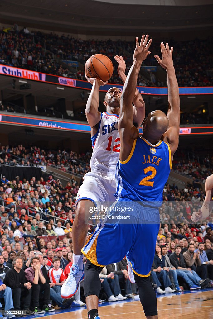 <a gi-track='captionPersonalityLinkClicked' href=/galleries/search?phrase=Evan+Turner&family=editorial&specificpeople=4665764 ng-click='$event.stopPropagation()'>Evan Turner</a> #12 of the Philadelphia 76ers drives to the basket against the Golden State Warriors on March 2, 2013 at the Wells Fargo Center in Philadelphia, Pennsylvania.