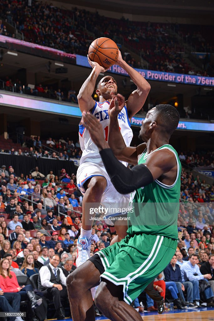 Evan Turner #12 of the Philadelphia 76ers drives to the basket against the Boston Celtics on March 5, 2013 at the Wells Fargo Center in Philadelphia, Pennsylvania.