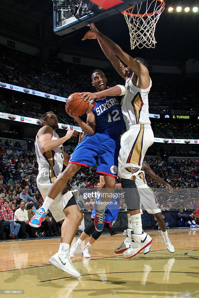 <a gi-track='captionPersonalityLinkClicked' href=/galleries/search?phrase=Evan+Turner&family=editorial&specificpeople=4665764 ng-click='$event.stopPropagation()'>Evan Turner</a> #12 of the Philadelphia 76ers drives to the basket against the New Orleans Pelicans on November 16, 2013 at the New Orleans Arena in New Orleans, Louisiana.