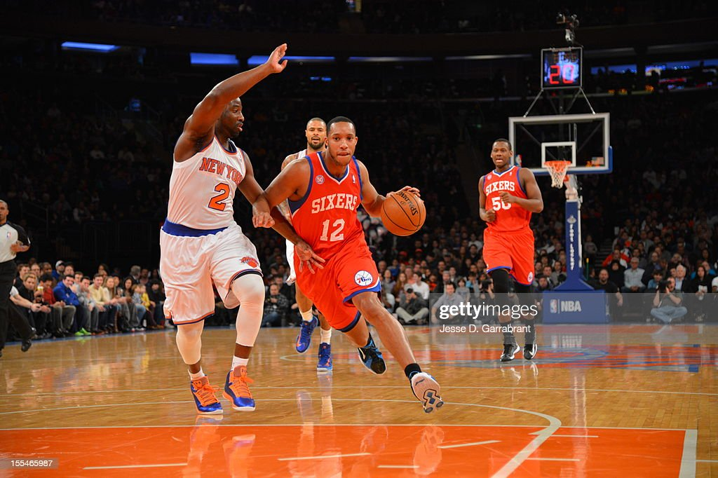 Evan Turner #12 of the Philadelphia 76ers drives to the basket Raymond Felton #2 of the New York Knicks on November 4, 2012 at Madison Square Garden in New York City.