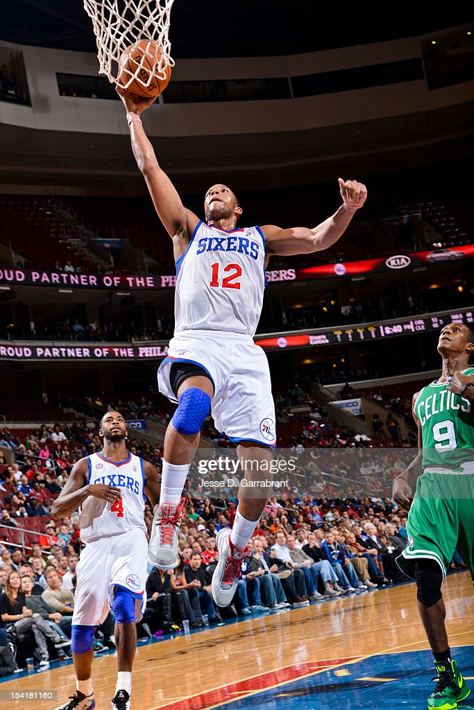 Evan Turner #12 of the Philadelphia 76ers dunks against the Boston Celtics during a pre-season game at the Wells Fargo Center on October 15, 2012 in Philadelphia, Pennsylvania.
