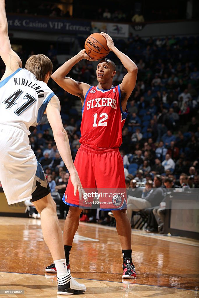 Evan Turner #12 of the Philadelphia 76ers faces defense of Andrei Kirilenko #47 of the Minnesota Timberwolves during the game between Philadelphia 76ers and the Minnesota Timberwolves on February 20, 2013 at Target Center in Minneapolis, Minnesota.