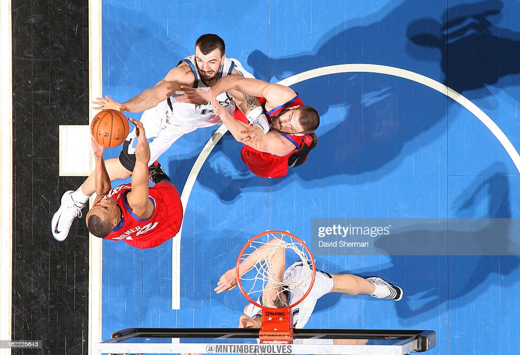 <a gi-track='captionPersonalityLinkClicked' href=/galleries/search?phrase=Evan+Turner&family=editorial&specificpeople=4665764 ng-click='$event.stopPropagation()'>Evan Turner</a> #12 of the Philadelphia 76ers gains the ball control against <a gi-track='captionPersonalityLinkClicked' href=/galleries/search?phrase=Nikola+Pekovic&family=editorial&specificpeople=829137 ng-click='$event.stopPropagation()'>Nikola Pekovic</a> #14 of the Minnesota Timberwolves during the game between Philadelphia 76ers and the Minnesota Timberwolves on February 20, 2013 at Target Center in Minneapolis, Minnesota.
