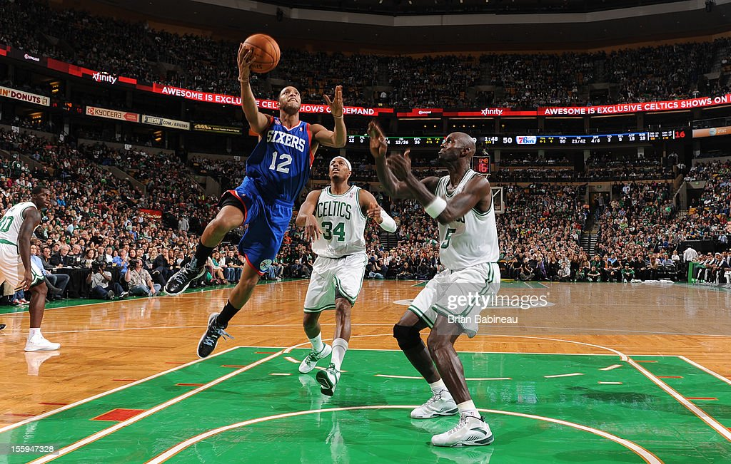 Evan Turner #12 of the Philadelphia 76ers goes in for the easy bucket vs Kevin Garnett #5 of the Boston Celtics on November 9, 2012 at the TD Garden in Boston, Massachusetts.