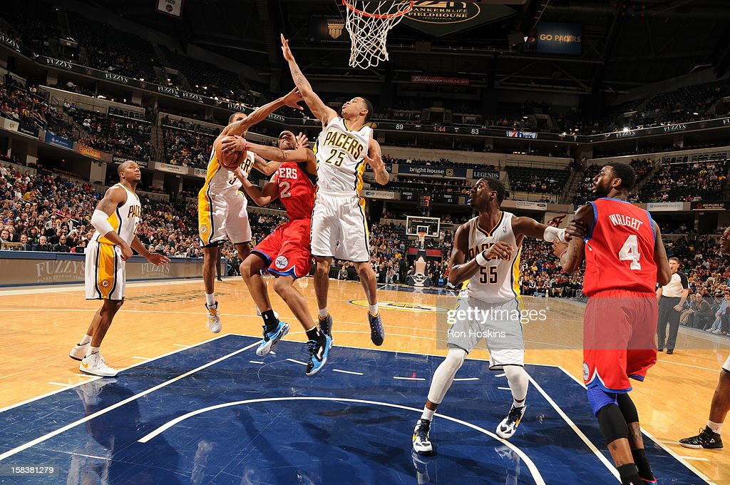 <a gi-track='captionPersonalityLinkClicked' href=/galleries/search?phrase=Evan+Turner&family=editorial&specificpeople=4665764 ng-click='$event.stopPropagation()'>Evan Turner</a> #12 of the Philadelphia 76ers goes to the basket against George Hill #3 and <a gi-track='captionPersonalityLinkClicked' href=/galleries/search?phrase=Gerald+Green&family=editorial&specificpeople=644655 ng-click='$event.stopPropagation()'>Gerald Green</a> #25 of the Indiana Pacers on December 14, 2012 at Bankers Life Fieldhouse in Indianapolis, Indiana.