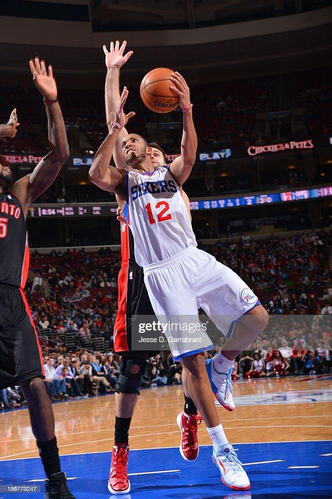 Evan Turner #12 of the Philadelphia 76ers goes to the basket against the Toronto Raptors at the Wells Fargo Center on November 20, 2012 in Philadelphia, Pennsylvania.