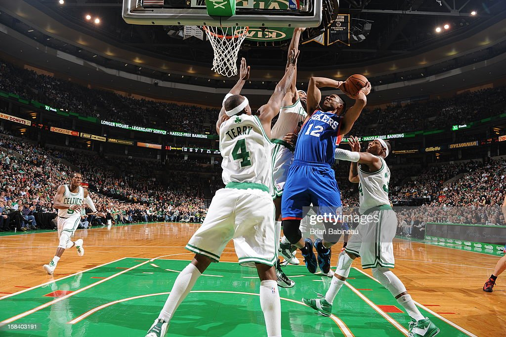 Evan Turner #12 of the Philadelphia 76ers goes to the basket against the Boston Celtics on December 8, 2012 at the TD Garden in Boston, Massachusetts.