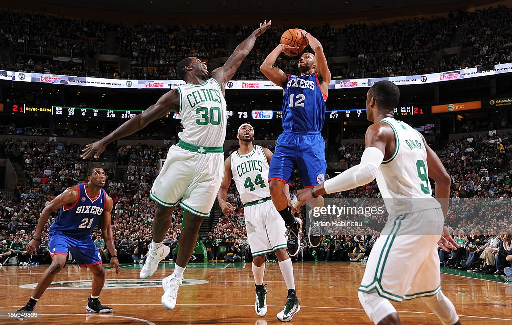 Evan Turner #12 of the Philadelphia 76ers goes up for a shot vs Brandon Bass #30 of the Boston Celtics on November 9, 2012 at the TD Garden in Boston, Massachusetts.