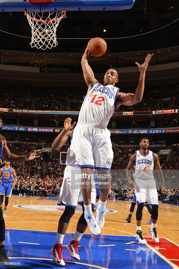 <a gi-track='captionPersonalityLinkClicked' href=/galleries/search?phrase=Evan+Turner&family=editorial&specificpeople=4665764 ng-click='$event.stopPropagation()'>Evan Turner</a> #12 of the Philadelphia 76ers grabs a rebound against the Golden State Warriors on March 2, 2013 at the Wells Fargo Center in Philadelphia, Pennsylvania.
