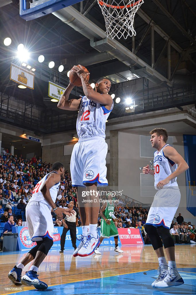 <a gi-track='captionPersonalityLinkClicked' href=/galleries/search?phrase=Evan+Turner&family=editorial&specificpeople=4665764 ng-click='$event.stopPropagation()'>Evan Turner</a> #12 of the Philadelphia 76ers grabs a rebound against the Boston Celtics at the Bob Carpenter Center on October 11, 2013 in Newark, Delaware.