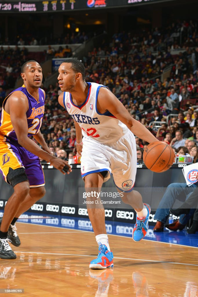 Evan Turner #12 of the Philadelphia 76ers handles the ball against Chris Duhon #21 of the Los Angeles Lakers on December 16, 2012 at the Wells Fargo Center in Philadelphia, Pennsylvania.