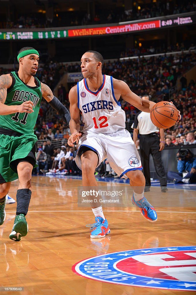 Evan Turner #12 of the Philadelphia 76ers handles the ball against Courtney Lee #11 of the Boston Celtics at the Wells Fargo Center on December 7, 2012 in Philadelphia, Pennsylvania.