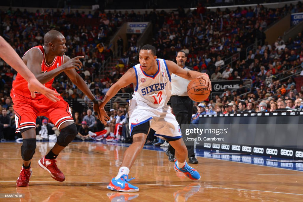 <a gi-track='captionPersonalityLinkClicked' href=/galleries/search?phrase=Evan+Turner&family=editorial&specificpeople=4665764 ng-click='$event.stopPropagation()'>Evan Turner</a> #12 of the Philadelphia 76ers handles the ball against <a gi-track='captionPersonalityLinkClicked' href=/galleries/search?phrase=Luol+Deng&family=editorial&specificpeople=202830 ng-click='$event.stopPropagation()'>Luol Deng</a> #9 of the Chicago Bulls on December 12, 2012 at the Wells Fargo Center in Philadelphia, Pennsylvania.