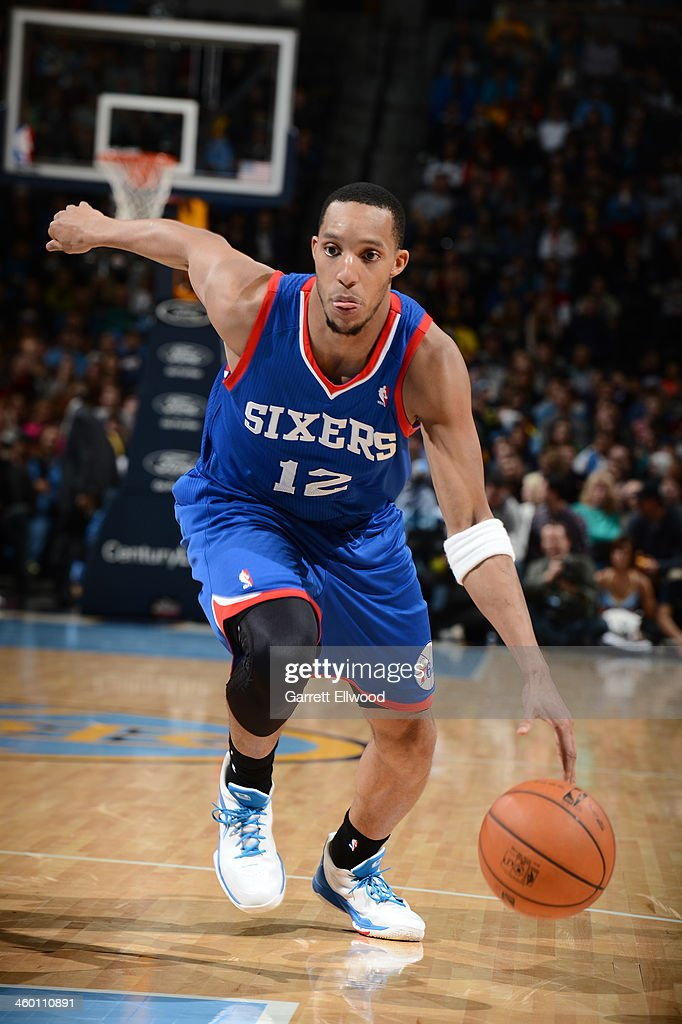 <a gi-track='captionPersonalityLinkClicked' href=/galleries/search?phrase=Evan+Turner&family=editorial&specificpeople=4665764 ng-click='$event.stopPropagation()'>Evan Turner</a> #12 of the Philadelphia 76ers handles the ball against the Denver Nuggets on January 1, 2014 at the Pepsi Center in Denver, Colorado.