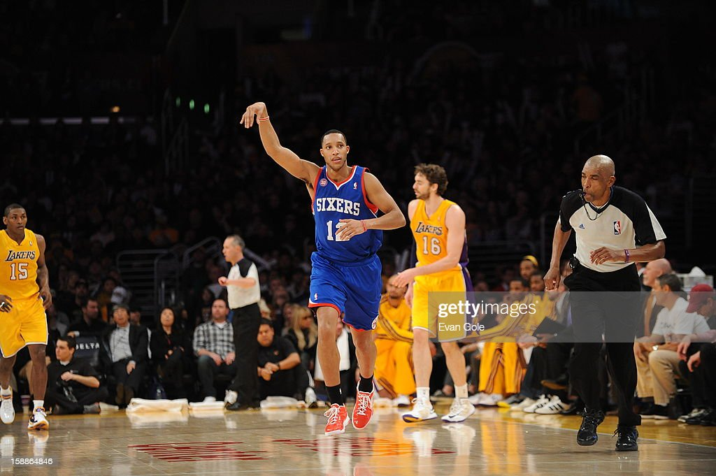Evan Turner #12 of the Philadelphia 76ers holds his hand up after draining a shot against the Los Angeles Lakers at Staples Center on January 1, 2013 in Los Angeles, California.