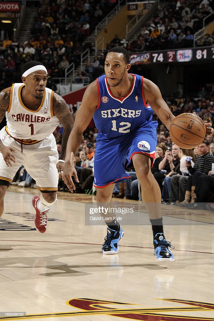 <a gi-track='captionPersonalityLinkClicked' href=/galleries/search?phrase=Evan+Turner&family=editorial&specificpeople=4665764 ng-click='$event.stopPropagation()'>Evan Turner</a> #12 of the Philadelphia 76ers looks to drive to the basket against the Cleveland Cavaliers at The Quicken Loans Arena on March 29, 2013 in Cleveland, Ohio.