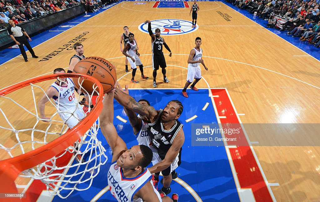 <a gi-track='captionPersonalityLinkClicked' href=/galleries/search?phrase=Evan+Turner&family=editorial&specificpeople=4665764 ng-click='$event.stopPropagation()'>Evan Turner</a> #12 of the Philadelphia 76ers rebounds against <a gi-track='captionPersonalityLinkClicked' href=/galleries/search?phrase=Kawhi+Leonard&family=editorial&specificpeople=6691012 ng-click='$event.stopPropagation()'>Kawhi Leonard</a> #2 of the San Antonio Spurs during the game at the Wells Fargo Center on January 21, 2013 in Philadelphia, Pennsylvania.