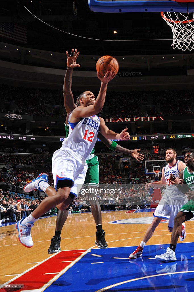 Evan Turner #12 of the Philadelphia 76ers shoots a layup against the Boston Celtics on March 5, 2013 at the Wells Fargo Center in Philadelphia, Pennsylvania.