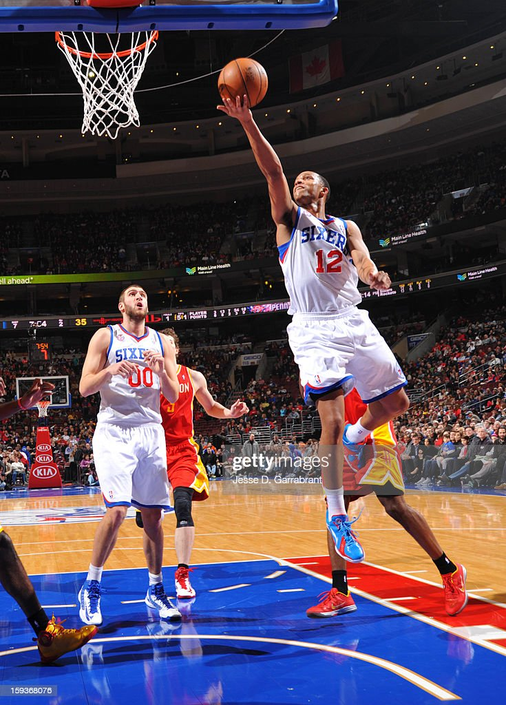 Evan Turner #12 of the Philadelphia 76ers shoots a layup against the Houston Rockets during the game at the Wells Fargo Center on January 12, 2013 in Philadelphia, Pennsylvania.