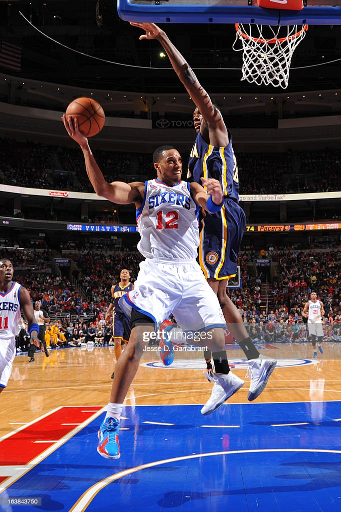 Evan Turner #12 of the Philadelphia 76ers shoots against Ian Mahinmi #28 of the Indiana Pacers at the Wells Fargo Center on March 16, 2013 in Philadelphia, Pennsylvania.