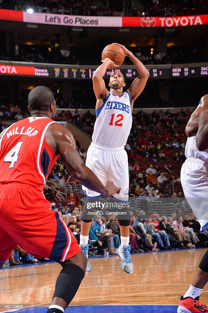<a gi-track='captionPersonalityLinkClicked' href=/galleries/search?phrase=Evan+Turner&family=editorial&specificpeople=4665764 ng-click='$event.stopPropagation()'>Evan Turner</a> #12 of the Philadelphia 76ers shoots against the Atlanta Hawks at the Wells Fargo Center on January 31, 2014 in Philadelphia, Pennsylvania.