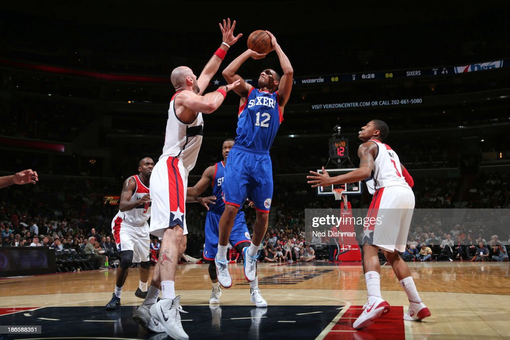 <a gi-track='captionPersonalityLinkClicked' href=/galleries/search?phrase=Evan+Turner&family=editorial&specificpeople=4665764 ng-click='$event.stopPropagation()'>Evan Turner</a> #12 of the Philadelphia 76ers shoots against the Washington Wizards during the game at the Verizon Center on November 1, 2013 in Washington, DC.