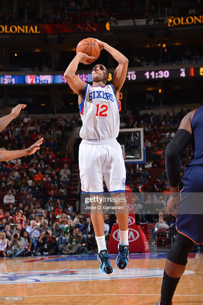 <a gi-track='captionPersonalityLinkClicked' href=/galleries/search?phrase=Evan+Turner&family=editorial&specificpeople=4665764 ng-click='$event.stopPropagation()'>Evan Turner</a> #12 of the Philadelphia 76ers takes a shot against the Charlotte Bobcats at the Wells Fargo Center on February 9, 2013 in Philadelphia, Pennsylvania.
