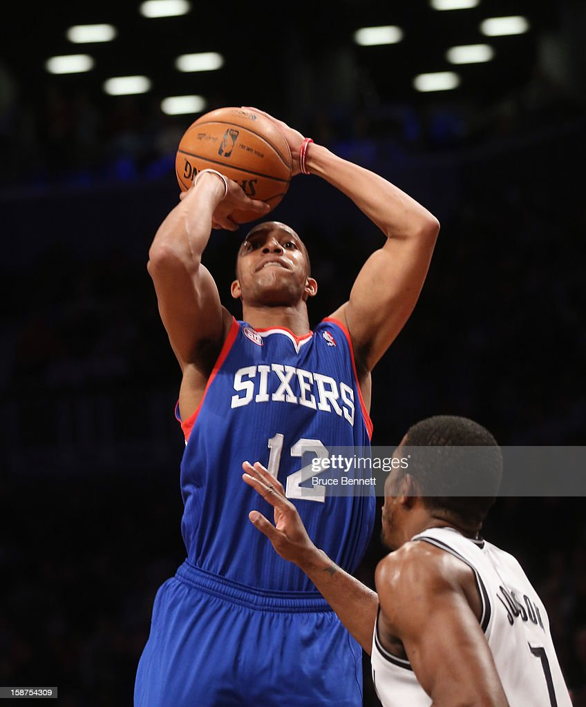 Evan Turner #12 of the Philadelphia 76ers takes the shot against the Brooklyn Nets at Barclays Center on December 23, 2012 in the Brooklyn borough of New York City.