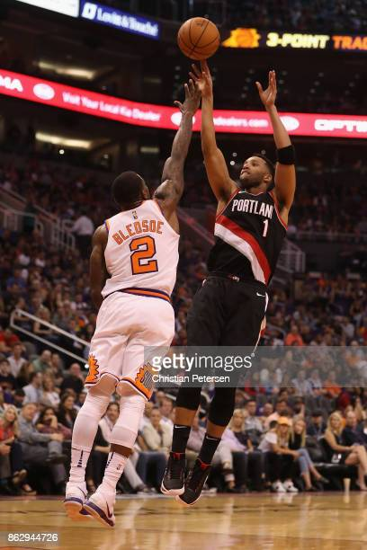 Evan Turner of the Portland Trail Blazers attempts a shot over Eric Bledsoe of the Phoenix Suns during the second half of the NBA game at Talking...