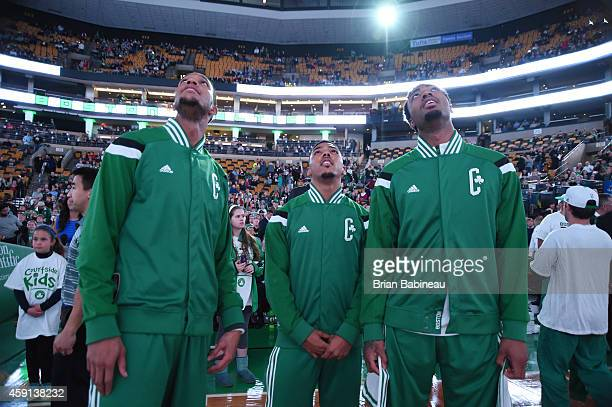 Evan Turner Phil Pressey and James Young of the Boston Celtics during national anthem before the game on November 17 2014 at TD Garden in Boston...