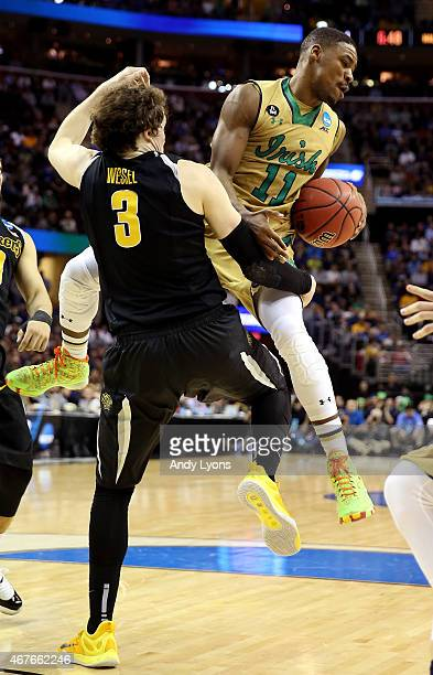 Evan Wessel of the Wichita State Shockers defends Demetrius Jackson of the Notre Dame Fighting Irish in the first half during the Midwest Regional...