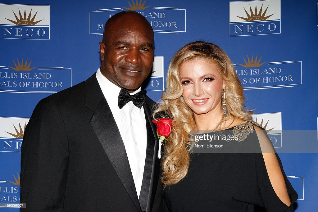 <a gi-track='captionPersonalityLinkClicked' href=/galleries/search?phrase=Evander+Holyfield&family=editorial&specificpeople=194938 ng-click='$event.stopPropagation()'>Evander Holyfield</a> and Marina Arsenijevic attend the 2014 Ellis Island Medals Of Honor at Ellis Island on May 10, 2014 in New York City.