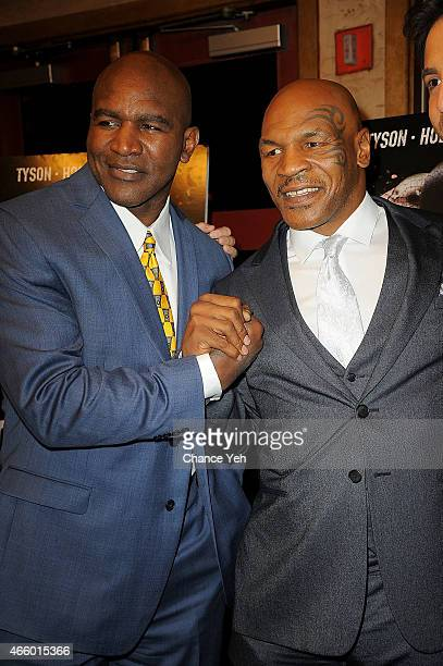Evander Holyfield and Mike Tyson attend 'Champs' New York Screening at Village East Cinema on March 12 2015 in New York City