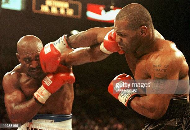 Evander Holyfield and Mike Tyson trade punches 28 June in their WBA heavyweight Cchampionship fight at the MGM Grand Garden Arena in Las Vegas NV...