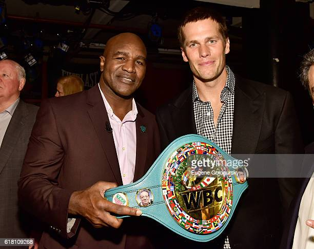 Evander Holyfield and Tom Brady attend the Muhammad Ali tribute event at Gleason's Gym on October 25 2016 in New York City
