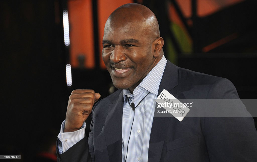 <a gi-track='captionPersonalityLinkClicked' href=/galleries/search?phrase=Evander+Holyfield&family=editorial&specificpeople=194938 ng-click='$event.stopPropagation()'>Evander Holyfield</a> enters the Celebrity Big Brother House at Elstree Studios on January 3, 2014 in Borehamwood, England.