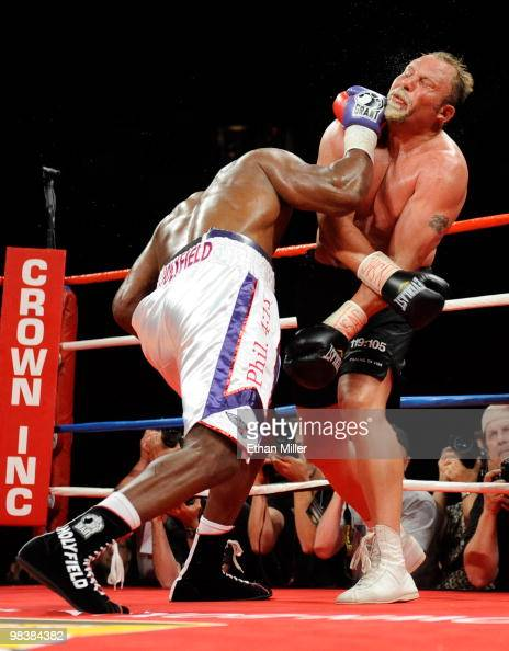 Evander Holyfield knocks Francois Botha to the canvas in the eighth round of their heavyweight bout shortly before Holyfield won by TKO at the Thomas...
