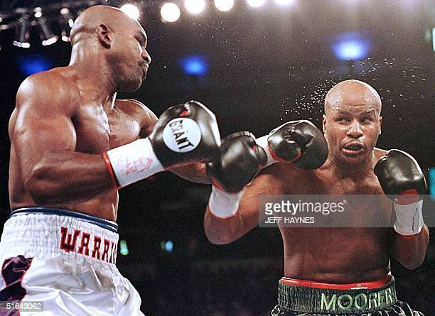 Evander Holyfield lands a left jab on Michael Moorer in the second round of their WBA/IBF Heavyweight Championship Unification fight 08 November in...