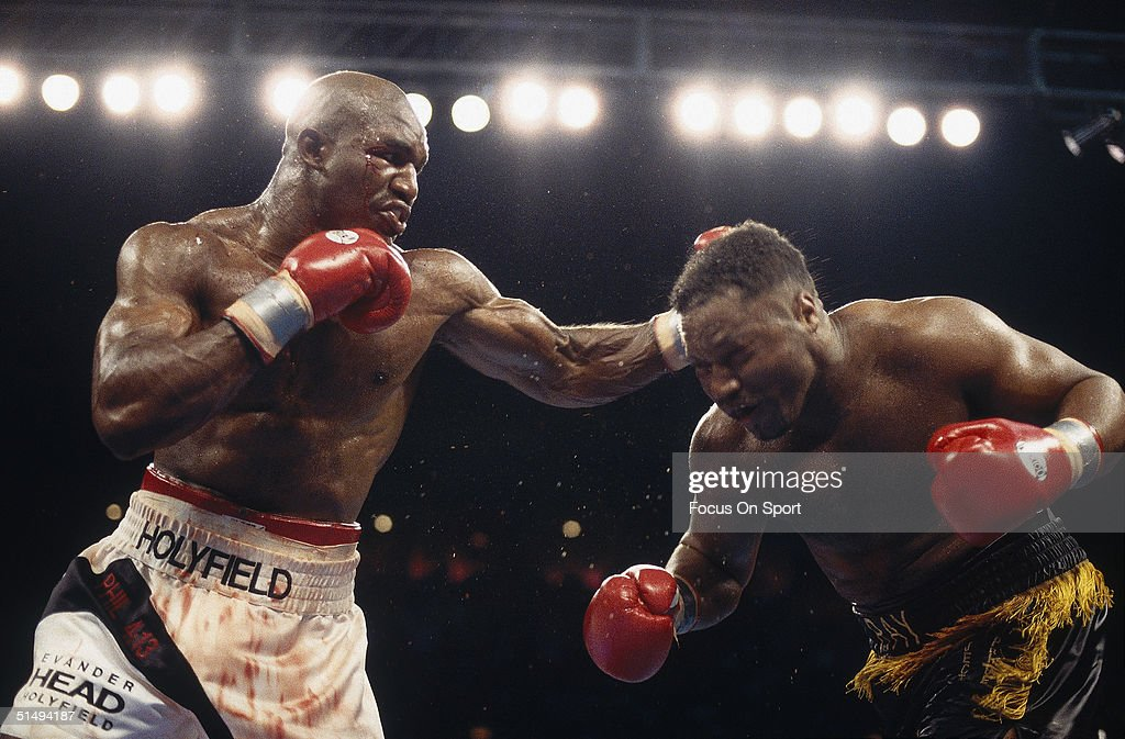 Evander Holyfield lands a punch to the back of Ray Murcer's Head in Atlantic City, New Jersey on May 20, 1995. Evander Holyfield was declared the winner in the 10th round of the bout.