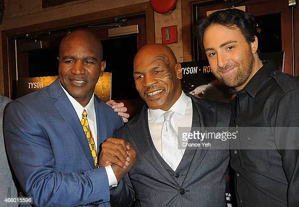 Evander Holyfield Mike Tyson and Bert Marcus attend 'Champs' New York Screening at Village East Cinema on March 12 2015 in New York City