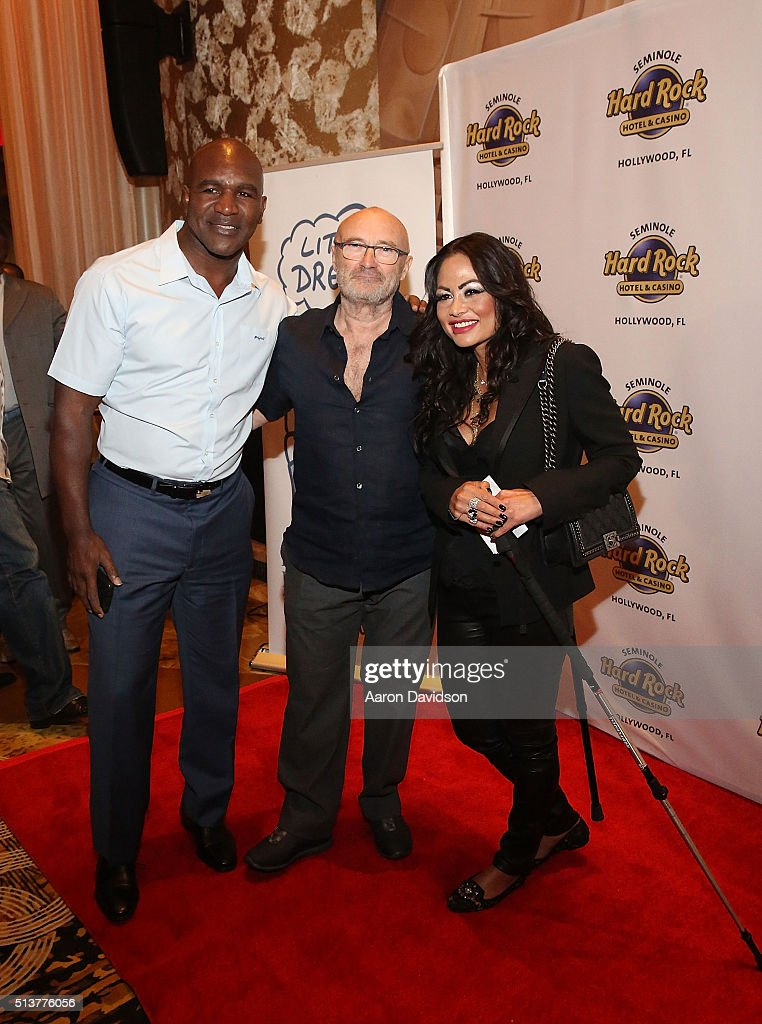 Evander Holyfield, Phil Collins, and Orianne Cevey attend Press Conference for the Little Dreams Foundation at Seminole Hard Rock Hotel & Casino - Hard Rock Cafe Hollywood on March 4, 2016 in Hollywood, Florida.
