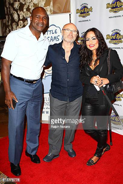 Evander Holyfield Phil Collins and Orianne Cevey pose for photos during Little Dreams Foundation Press Conference at LBar in Seminole Hard Rock Hotel...