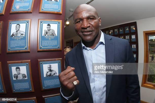 Evander Holyfield poses with his inductee ring during the International Boxing Hall of Fame induction Weekend of Champions event on June 11 2017 in...
